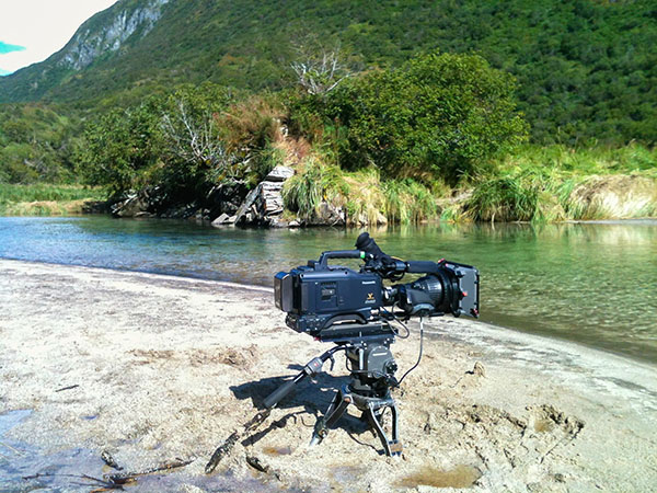 film camera set up along the shore of Alaskan river